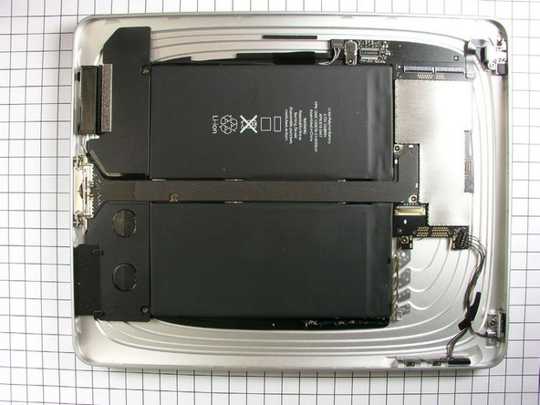 The battery is quite obvious to pick out of this picture of the rear case (sans display assembly).