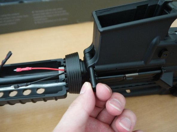 After the takedown pin is out of the way, slide the upper receiver forward. You will notice that the charging handle will get caught on a small nub on the top of the gearbox. Simply pull the charging handle back slightly and lift it over the nub.
