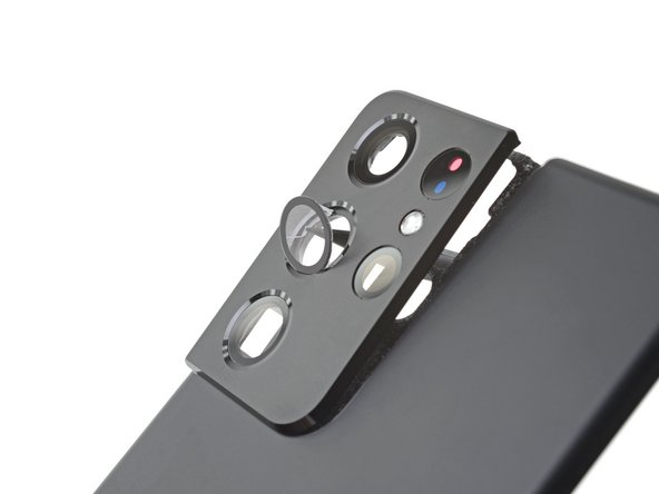 The same large adhesive gasket holds both the back cover and camera bump in place—but the bump can be carved off separately, making for some interesting DIY customization possibilities.