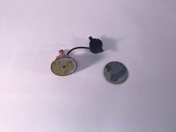 The photograph which lays on the left of the screen displays the process of tearing down the initial motor of the mobile fan.