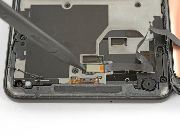 Use the point of a spudger to lift the digitizer cable connector up and out of its socket on the motherboard.