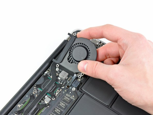 Lift the fan out of the upper case and carefully pull the fan ribbon cable out of its socket as you remove it from the Air.