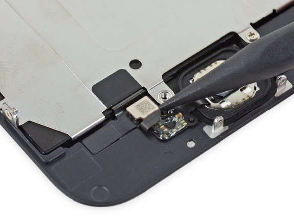 Use the point of a spudger to disconnect the home button cable connector by pushing it up and away from the home button.