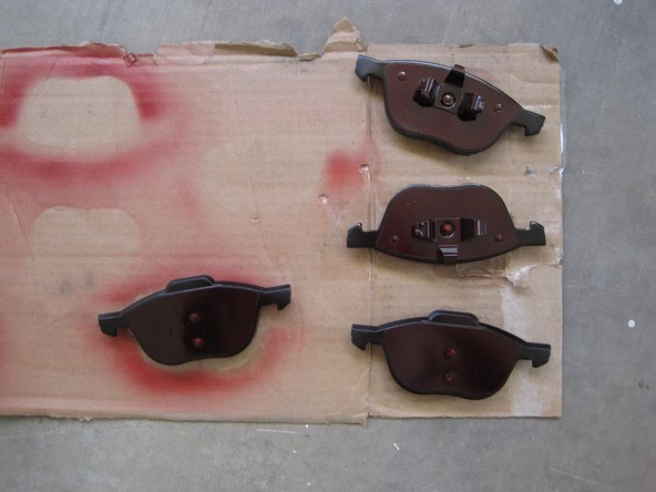 Coat the steel backing plates of the new brake pads with an anti-squeal coating.