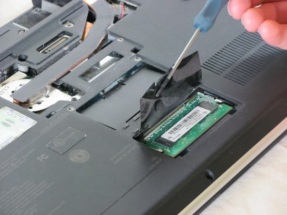 Lift the film covering to reveal the memory module with the tweezers.