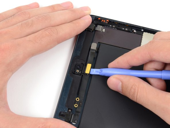 Gently fold the front-facing camera cable upwards (roughly at a 90-degree angle), exposing the bottom side of it.