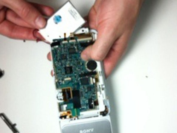 Loosen the battery from the motherboard.
