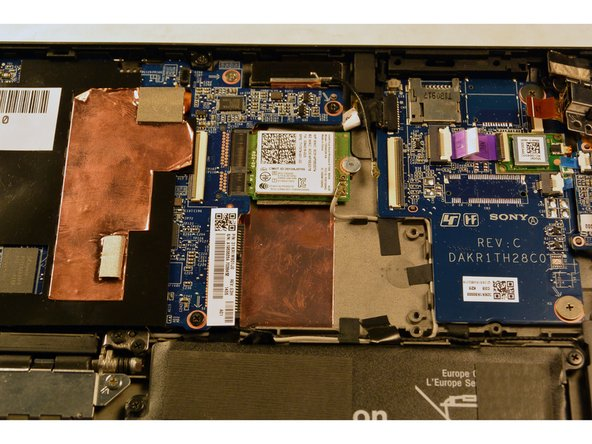 Remove the grey foam separator that was underneath the orange ribbon cable.