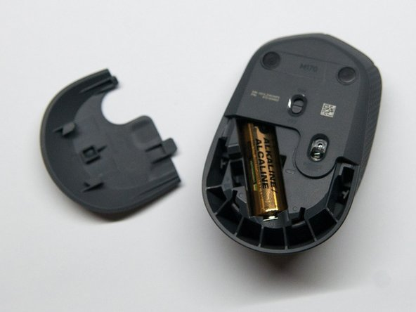 Switch off the mouse and slide out the bottom cover. This is where all the necessary clips can be accessed.