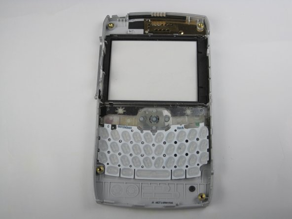 The keyboard is held in place with a little bit of glue.