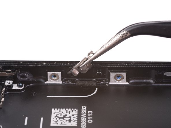 Pull the bracket from the rear case.