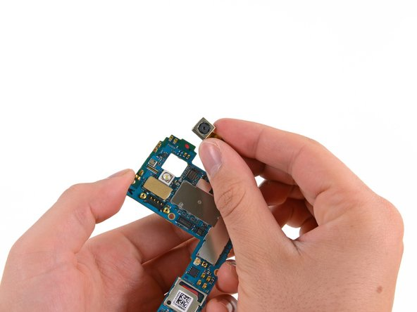 Once the motherboard is free, the rear-facing camera is easily removed.