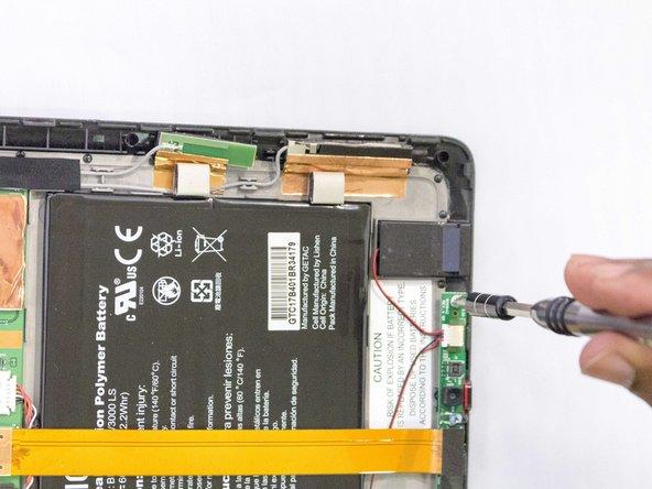 Remove screw with the J1 screwdriver or screw bit.