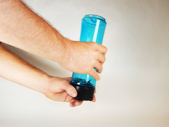 Grip the blade assembly with one hand and blender bottle with the other hand.