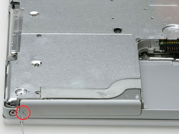 Use a straightened paperclip to open the optical drive tray.