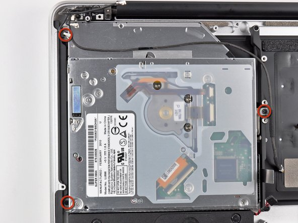 Remove the three 3.5 mm ( 3.3 mm ) T6 Torx screws securing the optical drive to the upper case.