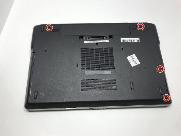 Remove the four screws to remove the back panel using the Phillips #00 screwdriver.