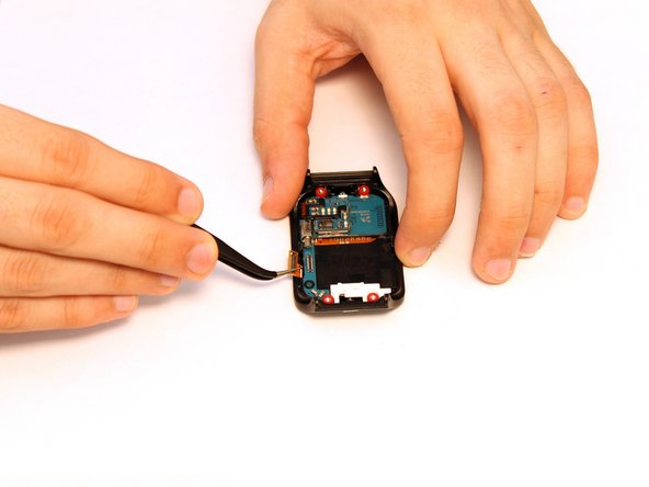 Using a pair of precision tweezers, gently grip and disconnect the AMOLED display connector from the mainboard.