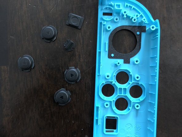 Use tweezers to remove all the buttons that you would like to replace.