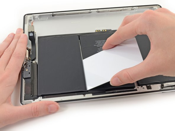 Gently pry the corner of the battery off of the case to begin freeing the final side of the dock side cell.