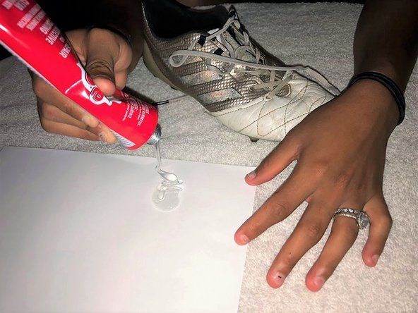 Squeeze out a good amount of the Shoe Goo onto the piece of printer paper.