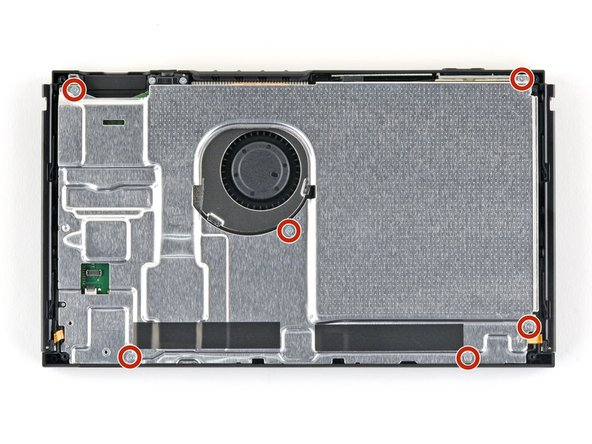 Use a JIS 000 screwdriver to remove the six 3 mm screws securing the shield plate to the device.