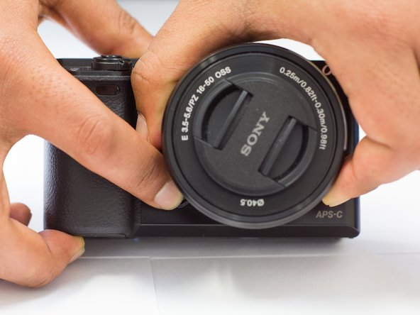 Using the left hand or the  right hand to hold the camera body, other hand twist the lens counterclockwise and pull it off.