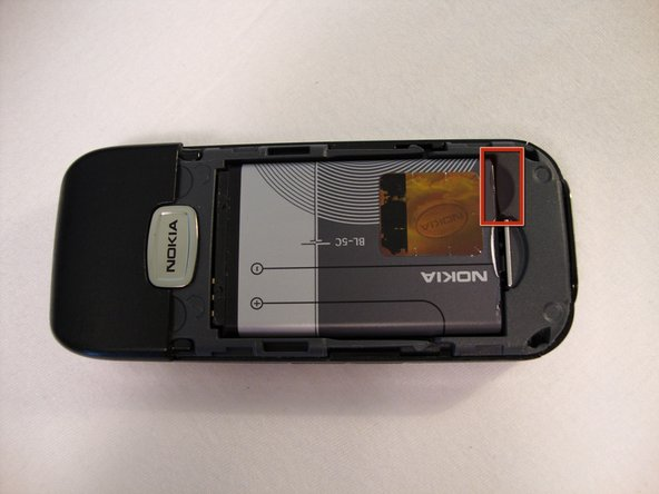Use your fingernail and gently pull the the bottom of the battery up.