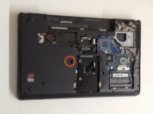Remove the screw, securing the Optical Drive.