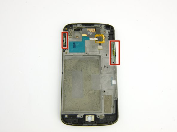 Remove the power and volume button switches from the display assembly.
