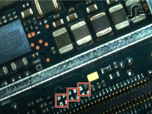 Apply solder to each of the three sets of four pins now exposed on the logic board.