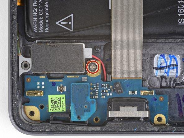 Remove one 2.4 mm Phillips screw.