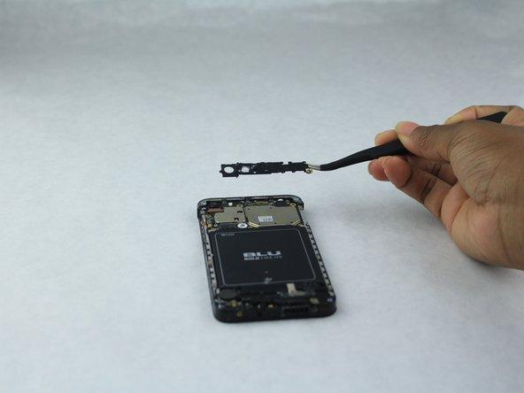 Using tweezers, remove the top black encasing of the camera.