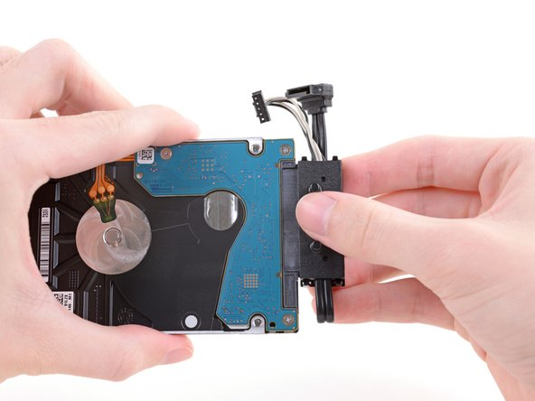 Unplug the hard drive connector from the hard drive by pulling parallel to the length of the drive.