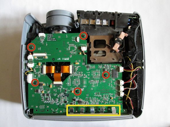 Use the T10 Torx screwdriver head to remove the five 5mm screws located throughout the motherboard with the screwdriver.