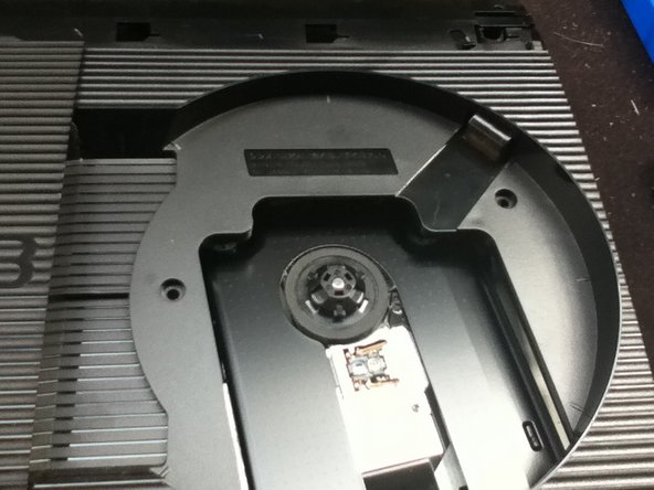 Remove two screws from the disk tray to remove the top.