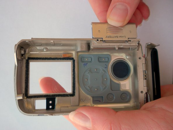 Open the battery cover and lift it up and off of back camera case.