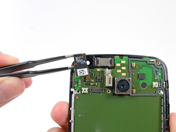 After selecting our favorite pair of precision tweezers, we remove the 2 MP front-facing camera from the Moto X.
