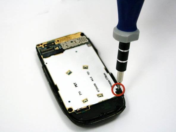 Use a T6 Torx Screwdriver to remove the screw located in the bottom right corner of the back panel.