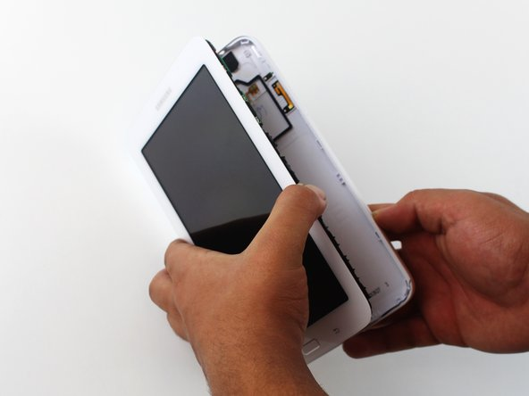 After separating the latches holding the screen and case together, slowly take the screen off the case.