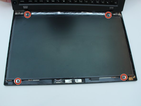 Remove the four 3.0 mm screws in the four corners of the screen with a Phillips #1 screwdriver bit.