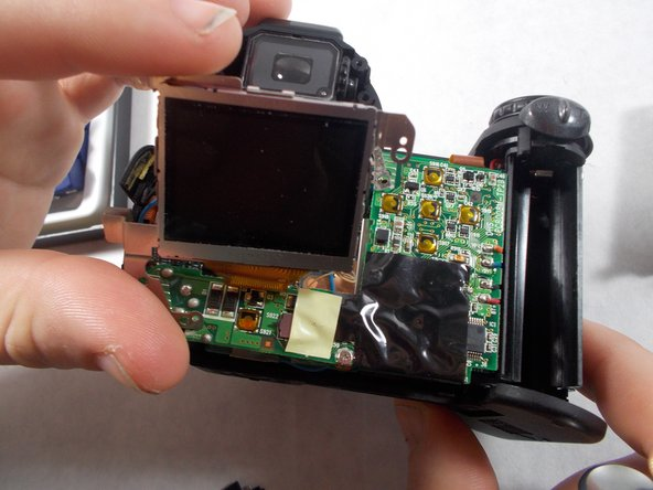 Gently remove the LCD screen from the circuit board.