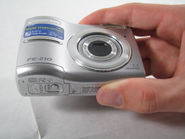 Removing Olympus FE-210 Batteries