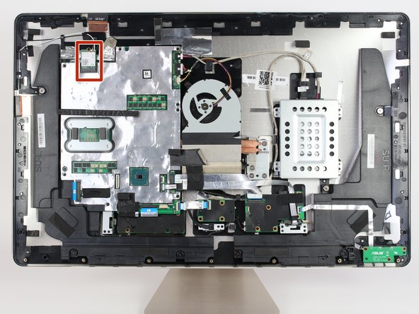 Locate the WLAN card  in the upper left hand corner of the computer.