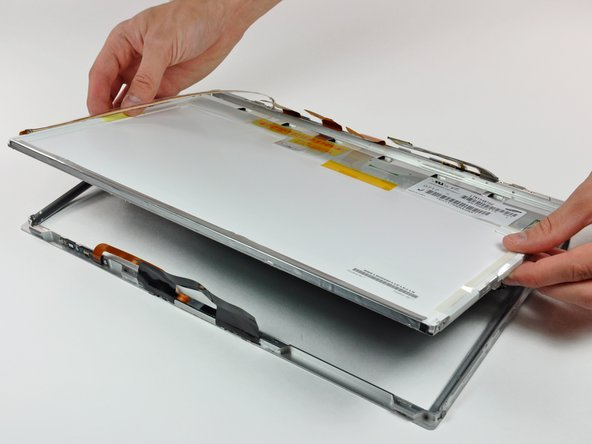 Lift the LCD out of the front bezel, minding any cables that may get caught.