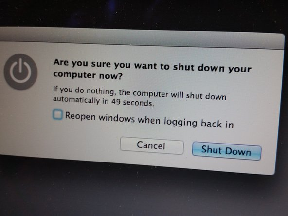 Attach the Macbook Air to power and shut it down.