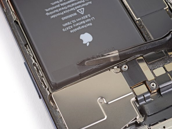 Peel up the two remaining battery adhesive pull-tabs to un-stick them from the top edge of the battery.