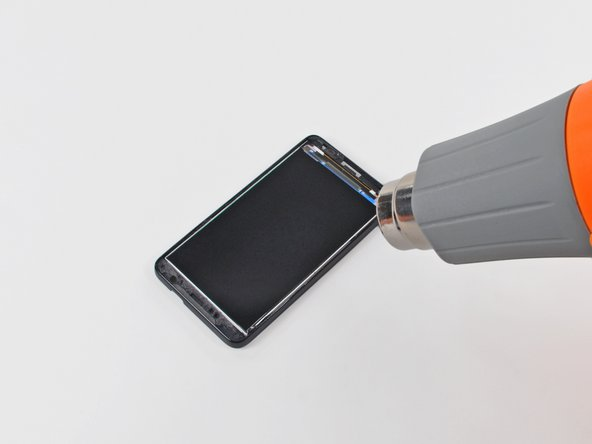 In the following steps, you will use a heat gun to soften the adhesive securing the underside of the LCD panel to the inner case. The area the adhesive is applied to is shown in red in the second picture (with the LCD removed).