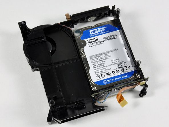 Flip over the internal framework with the newly attached drive. It should look like the first picture