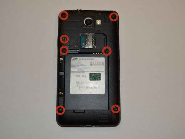 With the Phillips head screwdriver, remove all seven 4.0 mm screws, highlighted in red, from the rear case.